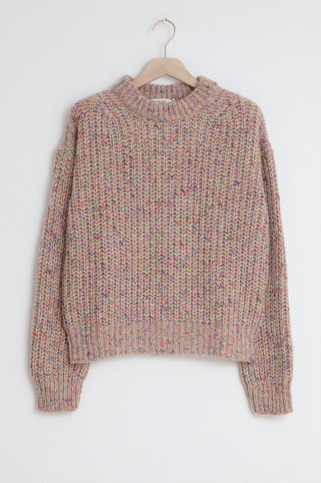 Roze gebreide trui