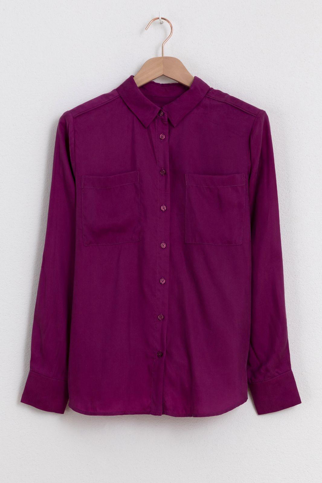 Paarse blouse met borstzakken