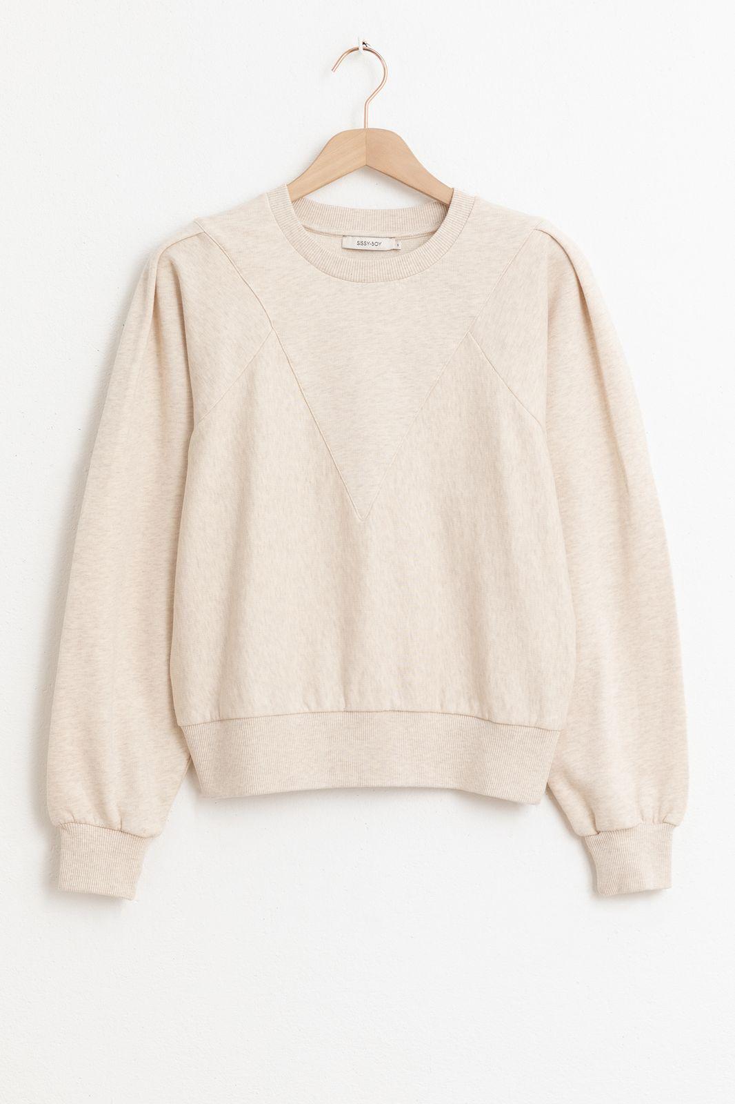 Beige sweater met pofmouw en gestikte details