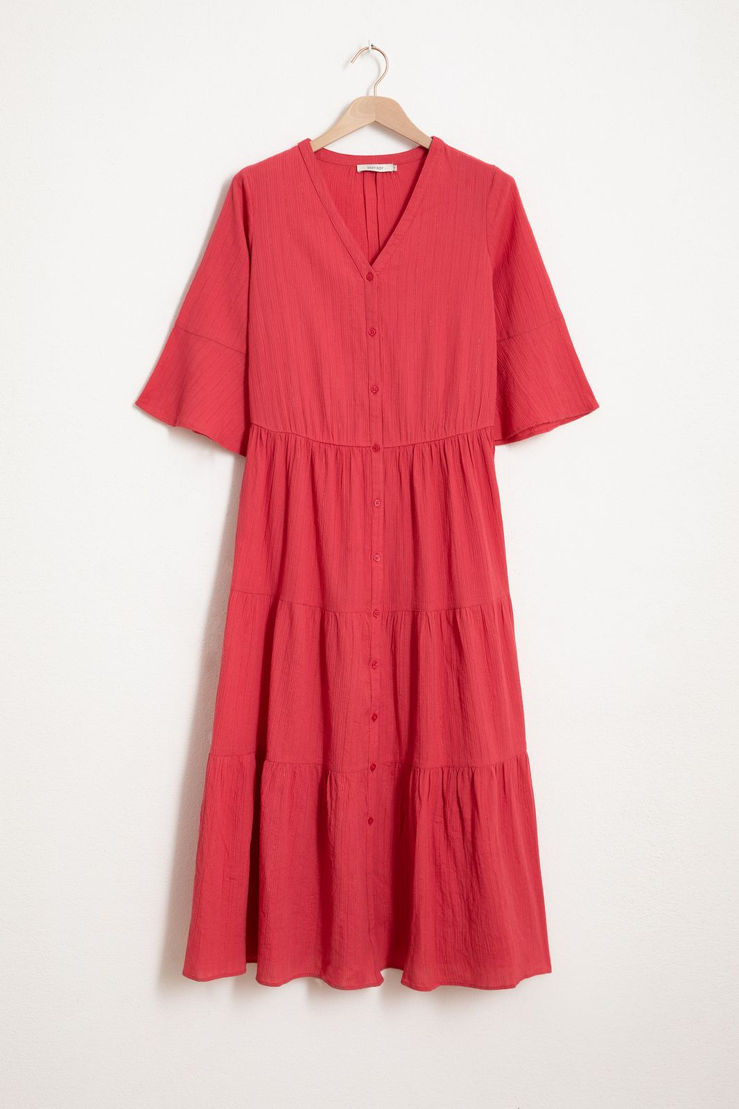 Roze maxi jurk met ruffles en trompet mouw