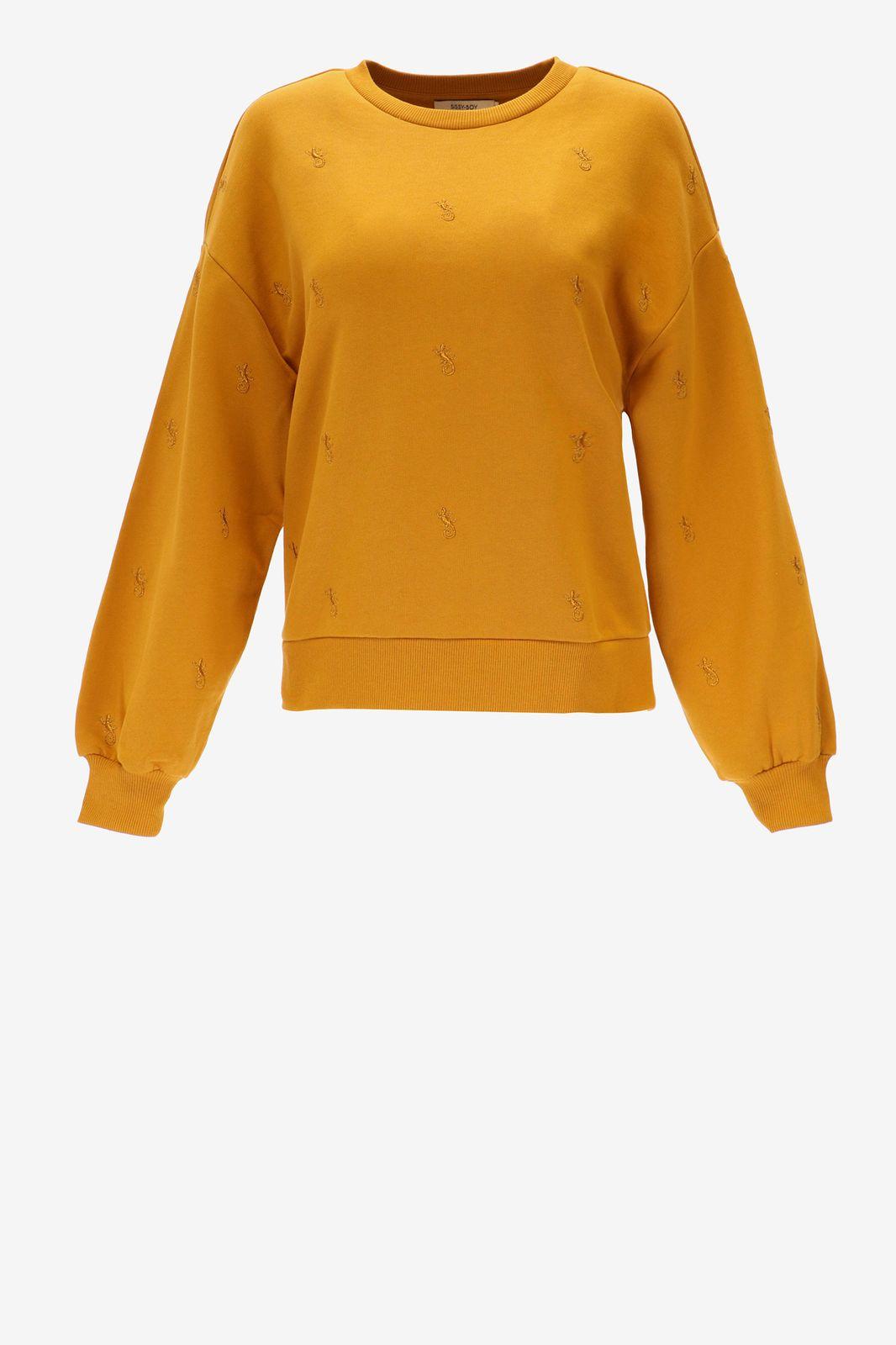 Okergele trui met geborduurde details