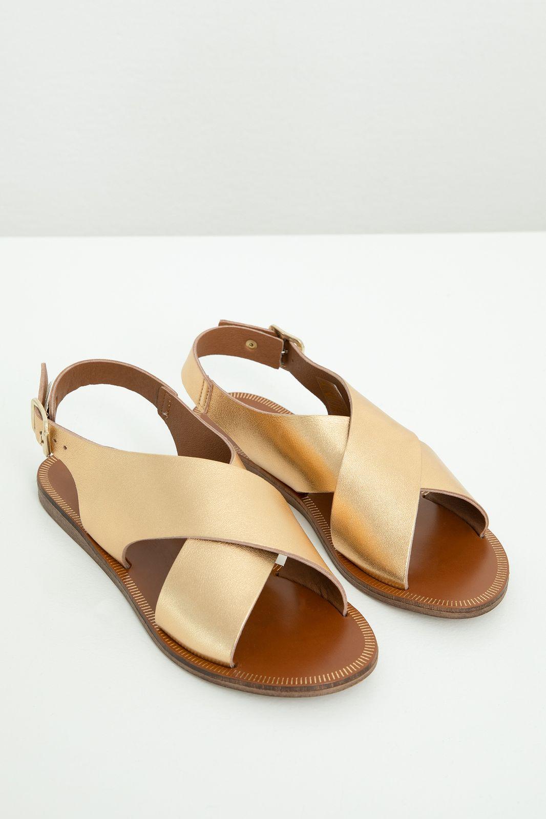 Goudkleurige leren sandalen met kruisbanden