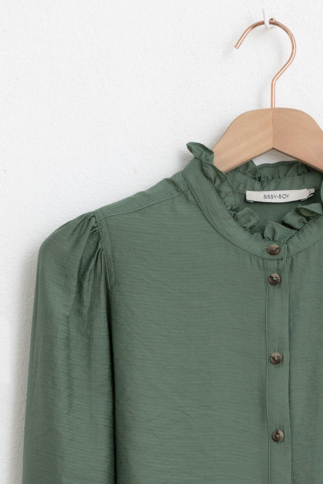 Groene blouse met ruffle details