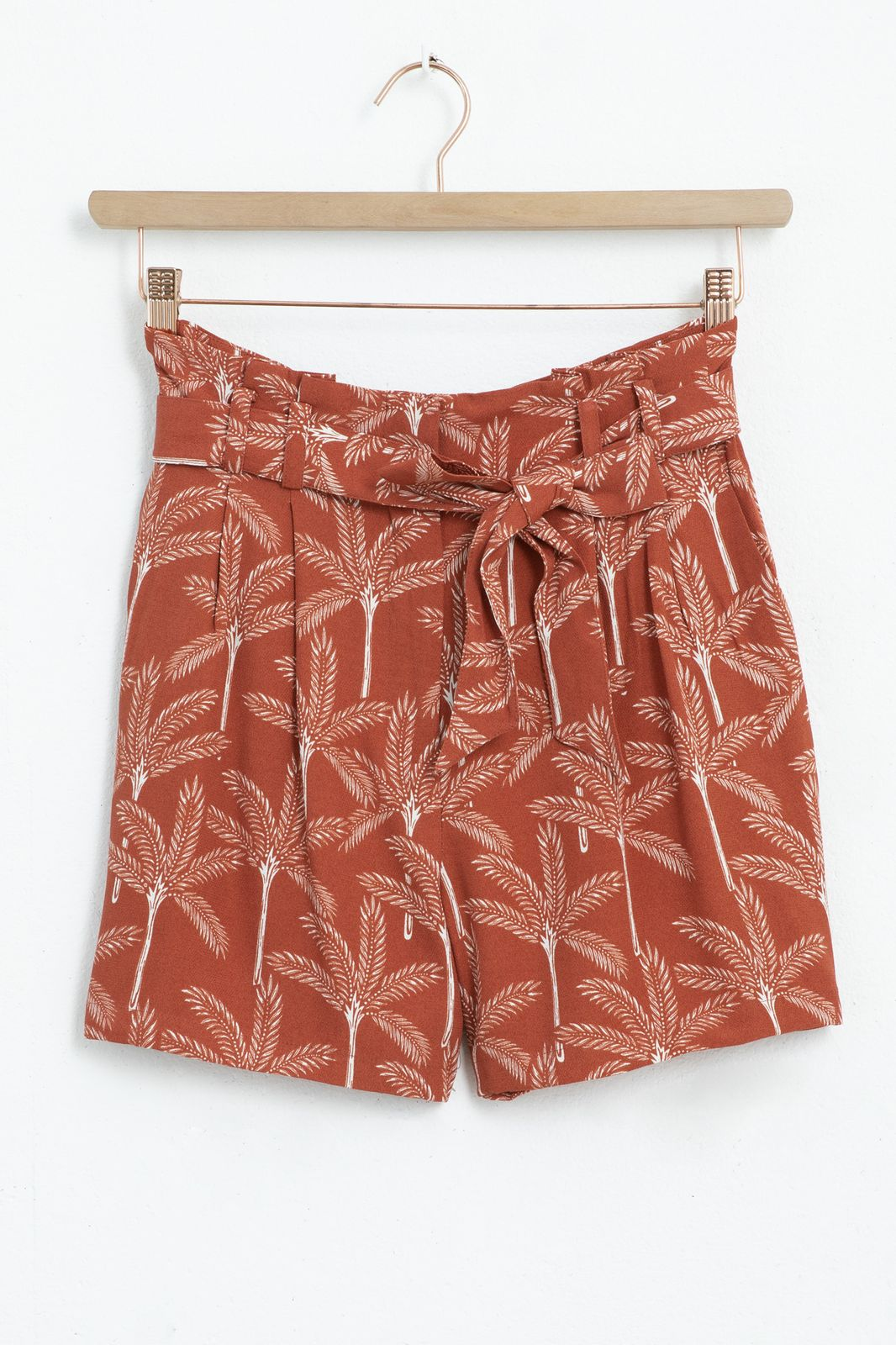 Rode paperbag shorts met all over palmboom print