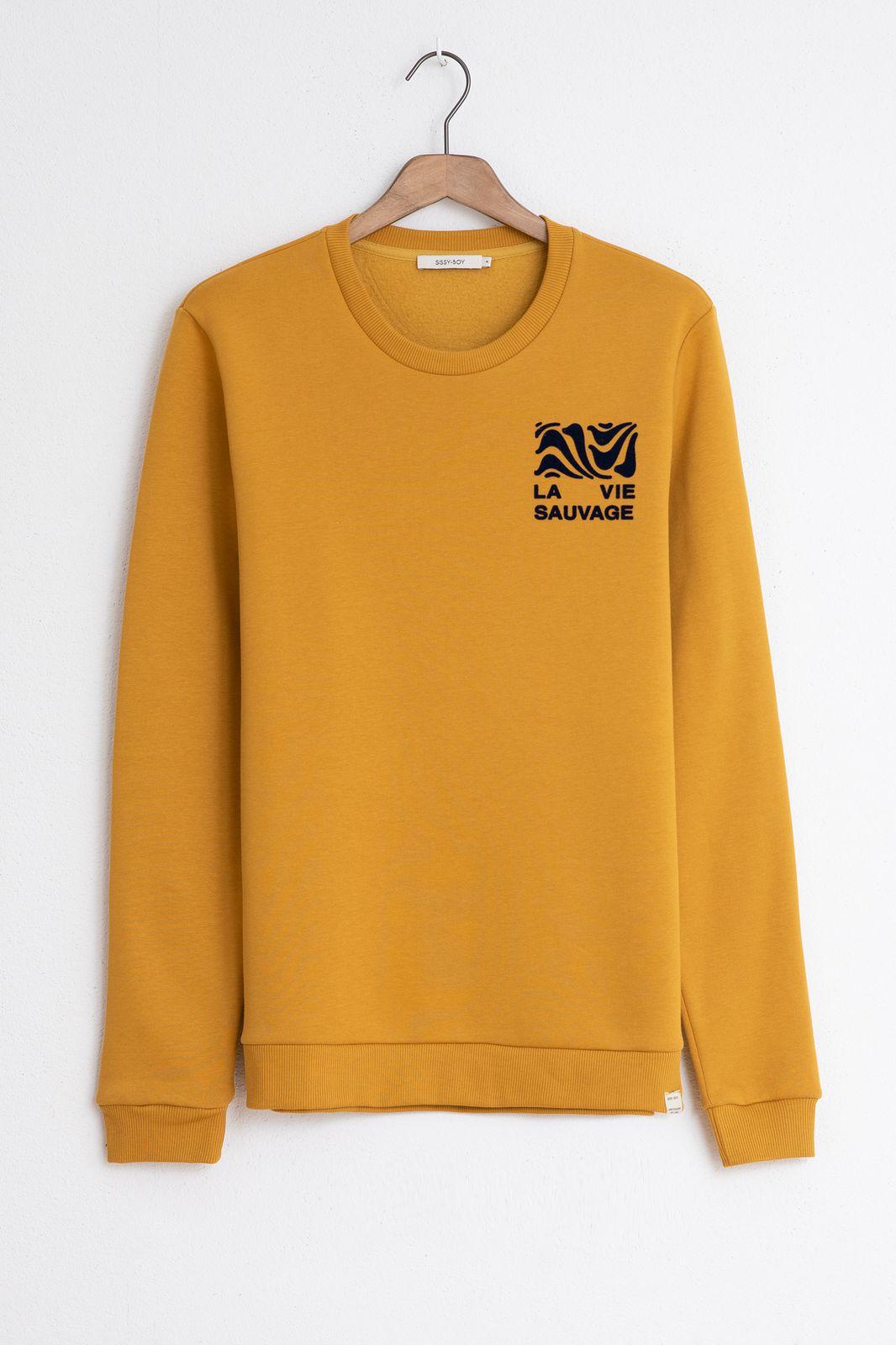 Gele sweater met borstprint