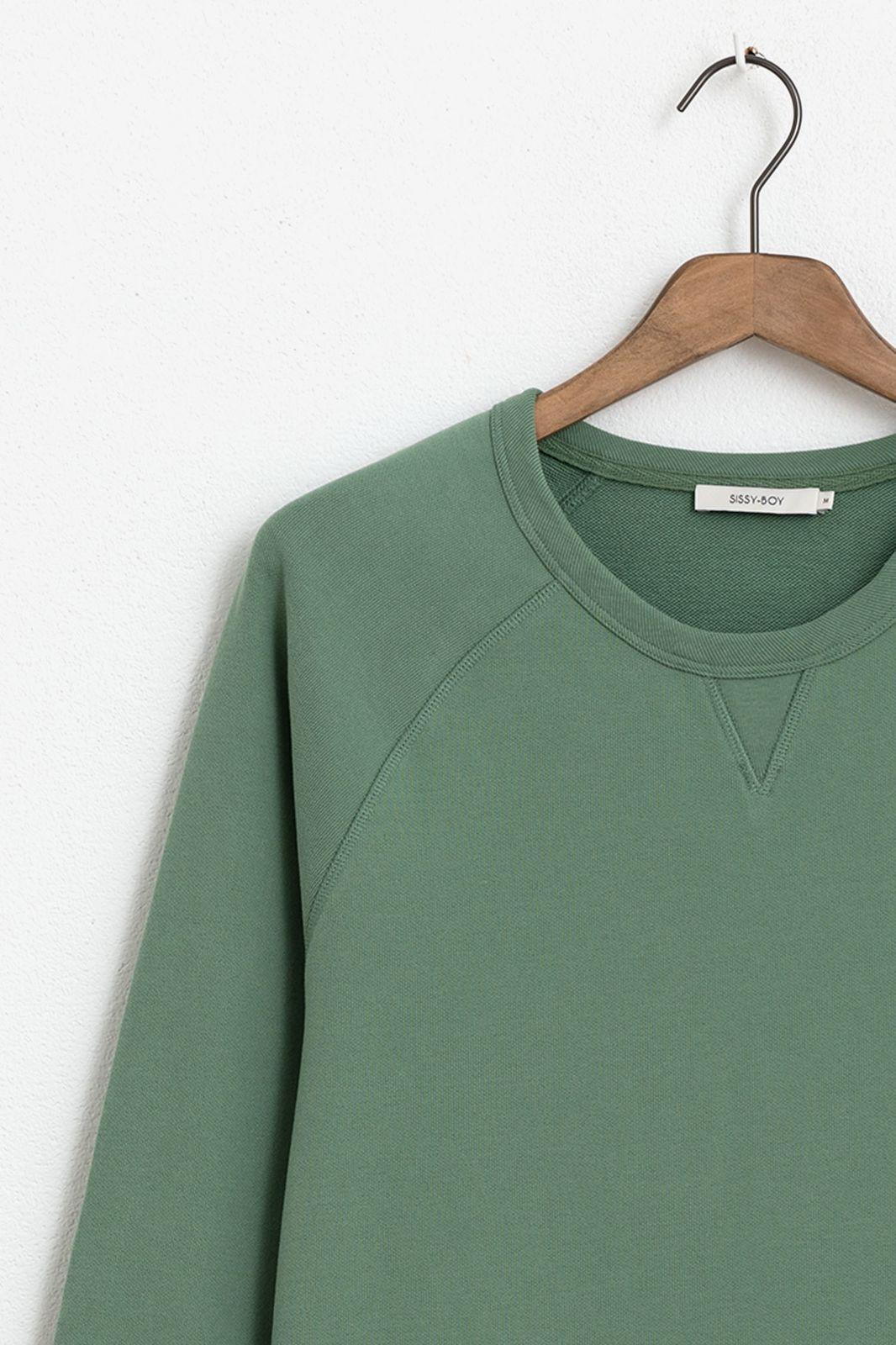 Groene sweater met raglan mouwen