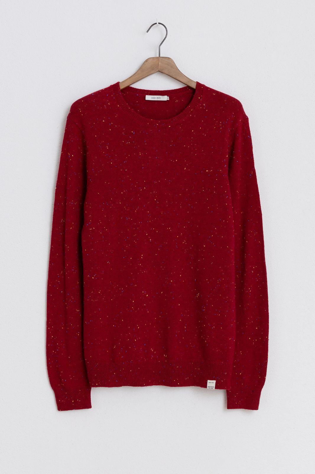Rode trui met gekleurde neps