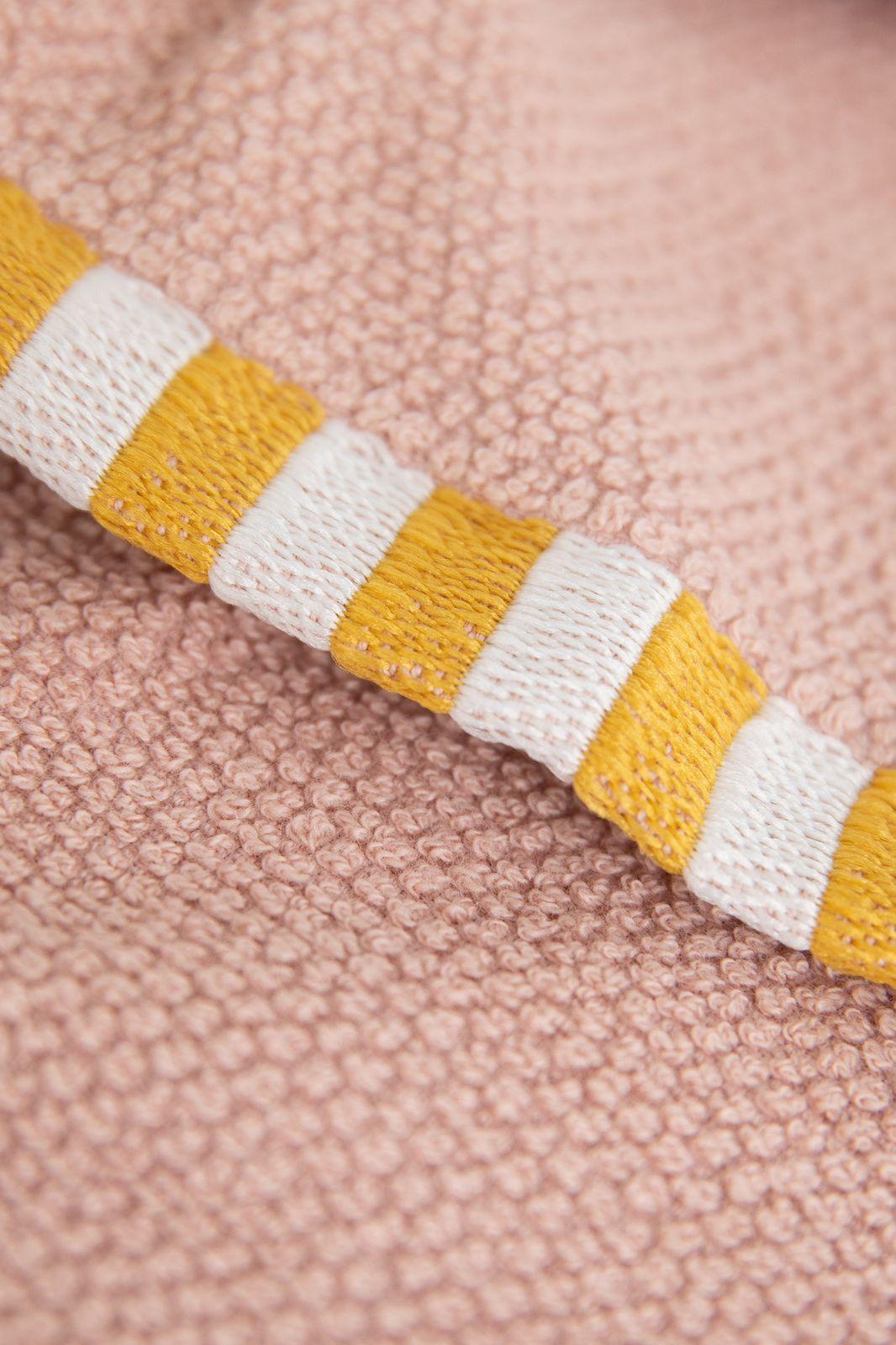 Roze gastenhanddoek met gestreepte border