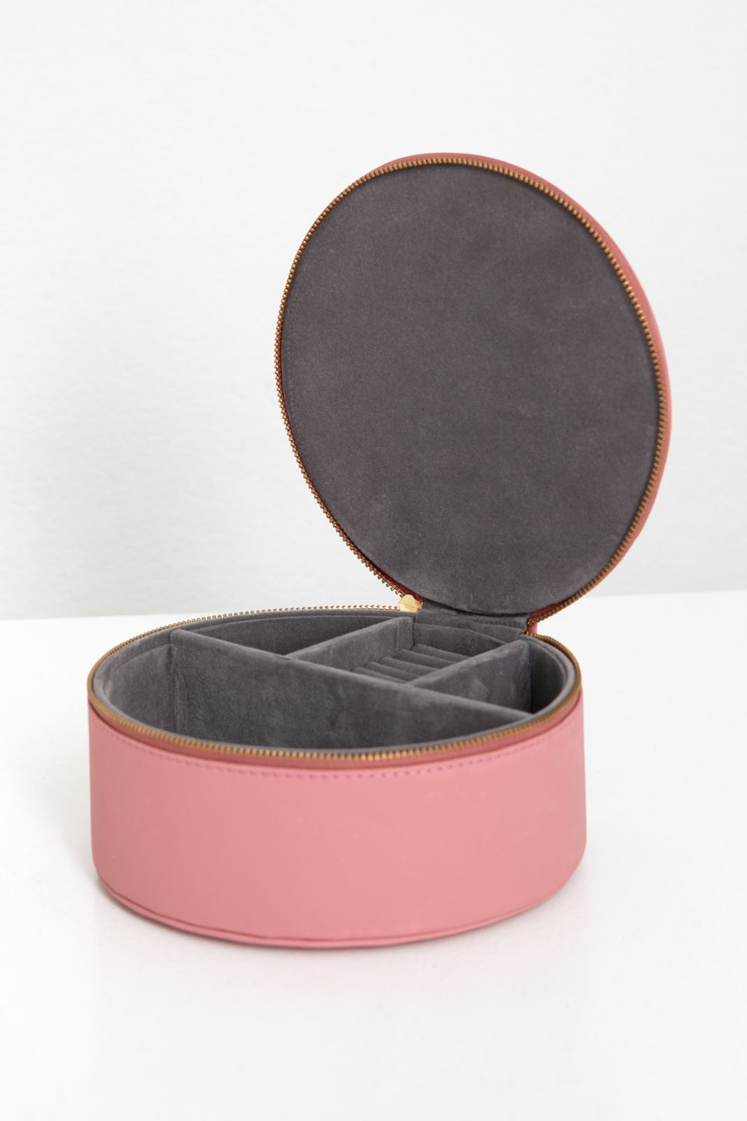 Roze ronde mini beauty case