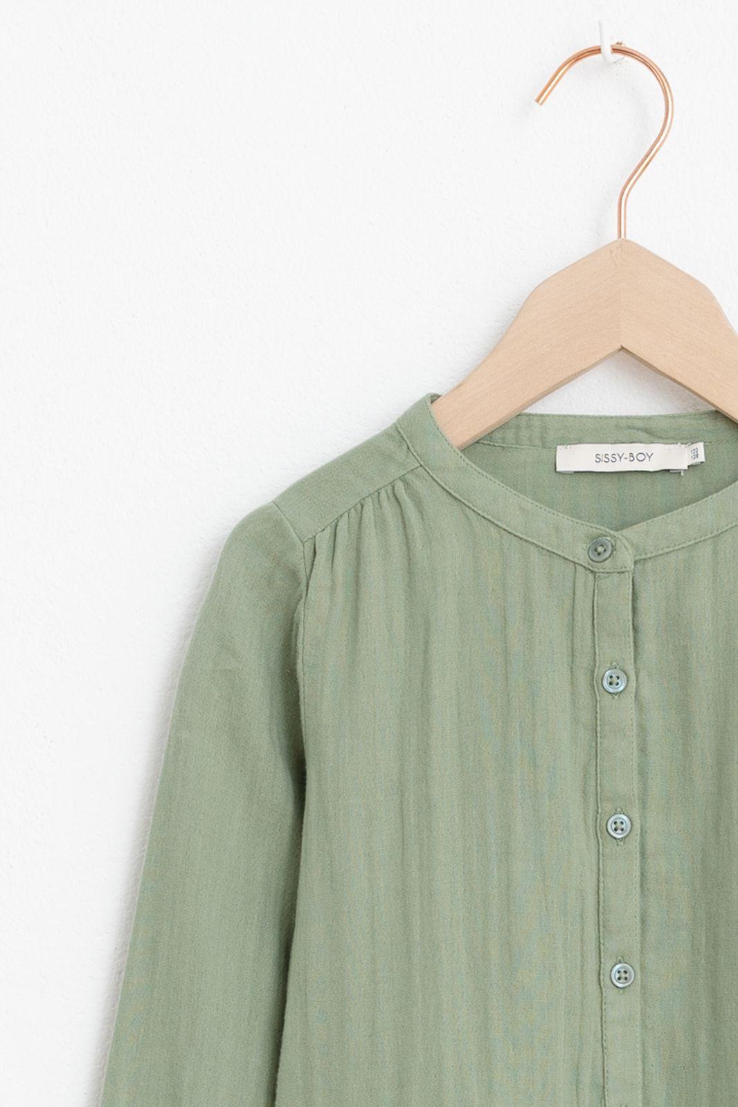 Groene jurk met steekzakken
