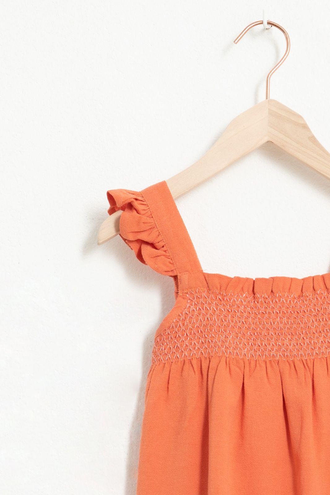 Oranje top met ruffle details